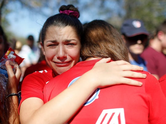 A student mourns the loss of her friend during a community vigil in Pine Trails Park in Parkland, Fla., on Feb. 15, 2018.