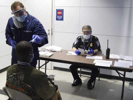 AP EBOLA TRAVEL BANS A FILE USA IL