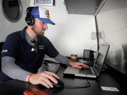 Brett Rogstad, a crew member who edits the interviews, is seen working on a laptop with an interview that was recently finished.