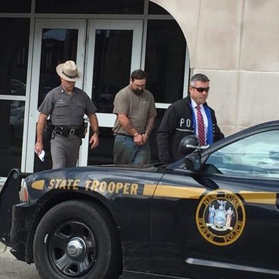 Paul Warner, center, is accused in a West Corners shooting.