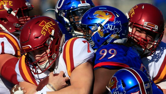 Iowa State quarterback Joel Lanning (7) is tackled by Kansas defensive tackle DeeIsaac Davis (99) during the first half of their game in Lawrence, Kan., Nov. 12.
