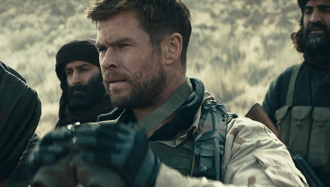 Chris Hemsworth looks to battle in the post-9/11 action drama '12 Strong.'