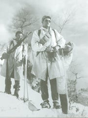 Lt. Don Traynor and his men prepare to scout German lines in winter camouflage and on skis soon after the 10th Mountain Division arrived in the front lines.