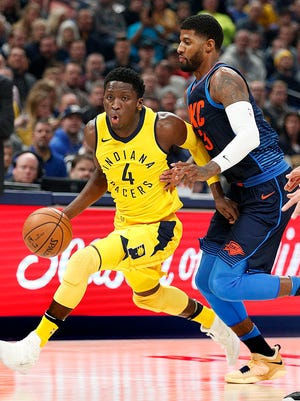 Victor Oladipo of the Indiana Pacers drives on Paul George of the Oklahoma City Thunder in the first half of their game at Bankers Life Fieldhouse Wednesday, Dec 13, 2017.