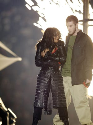 Janet Jackson covers up after Justin Timberlake ripped off her top during the halftime show of Super Bowl XXXVIII on Feb. 1, 2004.