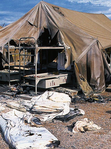 Oct. 1994: Charred mattresses are spread out in front of a tent used to house prisoners in Phoenix on Oct. 4, 1994. Inmates had set fire to several of the tents after becoming upset with living conditions. Due to jail overcrowding former Maricopa County Sheriff Joe Arpaio used the large army-style tents to house about 1,100 prisoners.