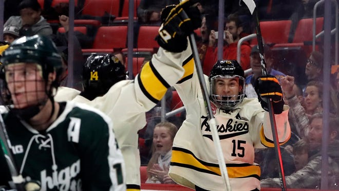 Michigan Tech forward Jake Lucchini (15) reacts after scoring during the second period of a Great Lakes Invitational college hockey game against Michigan State, Monday, Jan. 1, 2018, in Detroit.