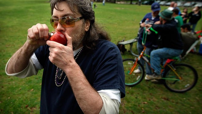 "Thorne ""The Kingpin"" Peters smokes marijuana out of an apple as a small group of marijuana legalization advocates gather at Overton Park for the annual observance of 4/20, the counterculture holiday, on April 20, 2011. Peters was found dead Sunday in a Shelby County prison, authorities said."