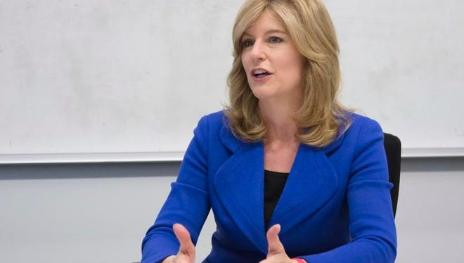 """Kathleen Murphy is president of Fidelity Personal Investing, a unit of Fidelity Investments. """"When women actually take the step of investing, they do a good job,"""" says Murphy."""
