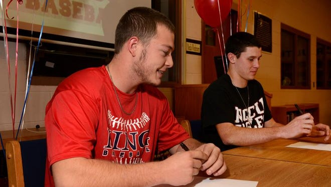 West Henderson's Grant Anderson (King), left, and Dustie Fender (N.C. Central) have signed to play college baseball.