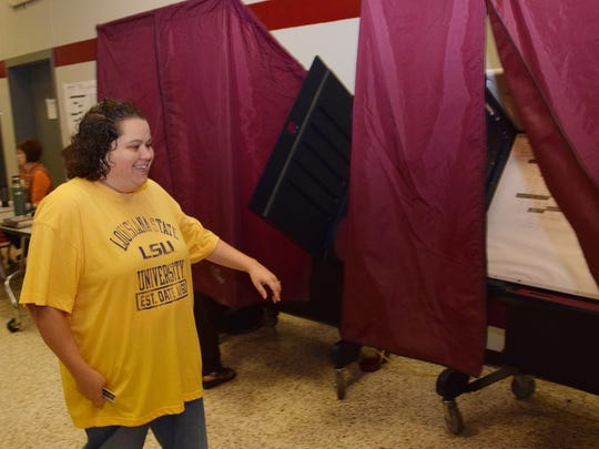 Mandy Maxwell Goodnight walks to the voting booth at Pineville High School to vote Saturday.