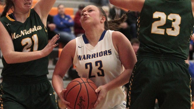 Mariemont's Olivia Griffith fights through the traffic on her way to the basket Tuesday against McNicholas. The Warriors topped the Rockets, 56-35.