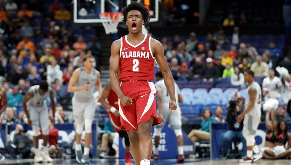Alabama's Collin Sexton celebrates after a teammate's