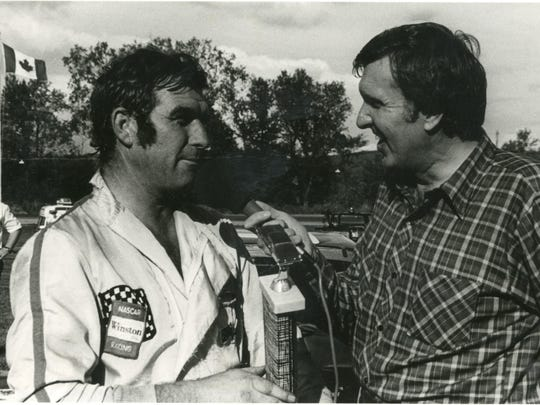 Ken Squier, right, interviews Norm Andrews after a race, circa 1975.