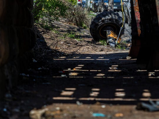 A wheel from a piece of construction equipment rests on the side of Booth Street near Sixth Street under the railway overpass after an Amtrak train struck a piece of construction equipment on the tracks in Chester, Pa. on Sunday morning.