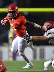 Brentwood Academy's Tomario Pleasant (5) pushes off