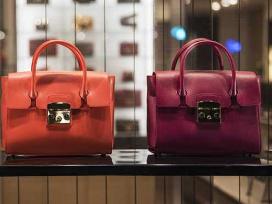 Three handbags are lined up.