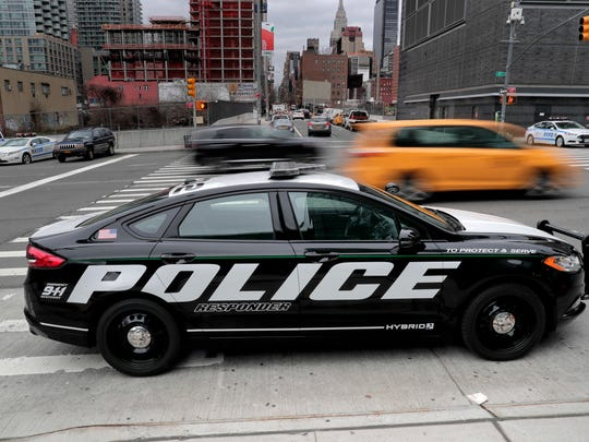A prototype of the Ford Fusion police hybrid car sits