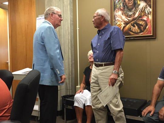 Former Vineland Mayor Harry Curley (left) talks with