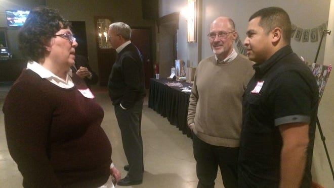 From left, Ronda Seubert talks with Jim Radey and his son, Blake Radey, during a retirement celebration for Jim at Green Bay Distillery in Ashwaubenon on Wednesday, March 15, 2017. Jim Radey worked nearly 30 years as the director of the Retired and Senior Volunteer Program (RSVP) for The Volunteer Center of Brown County. Seubert replaced Radey.