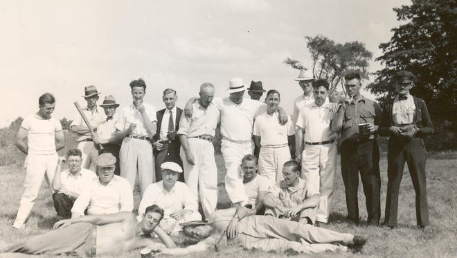 Members of the Fireman's Association (circa 1940s) pose after one of their annual picnic baseball games.
