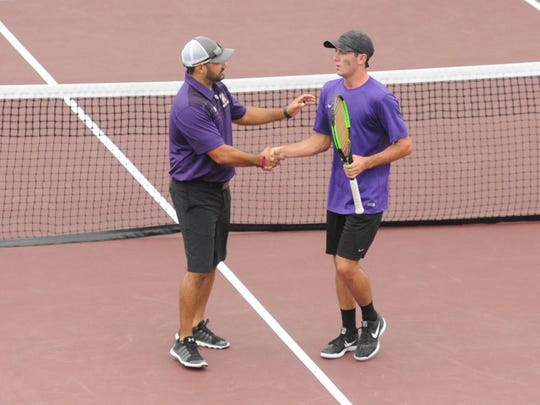 Wylie coach Brent Abilez, left, congratulates Lane Adkins after his 6-1, 6-1 win at No. 1 boys singles against Fredericksburg in the Class 4A state finals on Thursday, Nov. 2, 2017 at the George P. Mitchell Tennis Center in College Station. The win clinched Wylie's 10-0 victory.