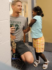 Brielle Trice ,4, runs to dad, Dan Chichon, after the conclusion of her therapy on Wednesday at Morrow County Hospital.