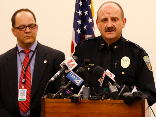 Everest Metro Police Chief Wally Sparks speaks to news media about shootings Wednesday that killed four, including a member of his department. At left, state Department of Justice Deputy Administrator Jason Smith looks on.
