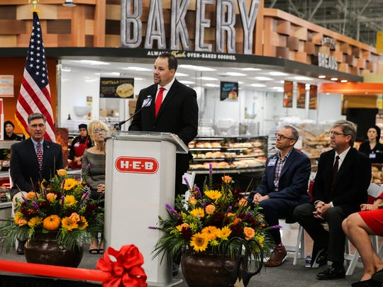 Store Manager Nick George talks during the ribbon cutting