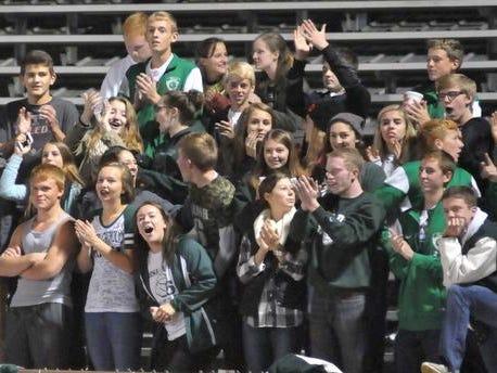 Fisher Catholic students celebrate at home team score. Fisher Catholic took on Worthington Christian Saturday night at Fulton Field. David Stith/Eagle-Gazette