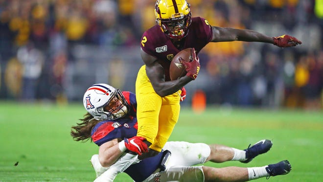 Arizona linebacker Colin Schooler tackles Arizona State  wide receiver Brandon Aiyuk (2) during a game last November. Schooler, who averaged 104 tackles over three seasons with the Wildcats, announced Sunday he has transferred to Texas Tech.