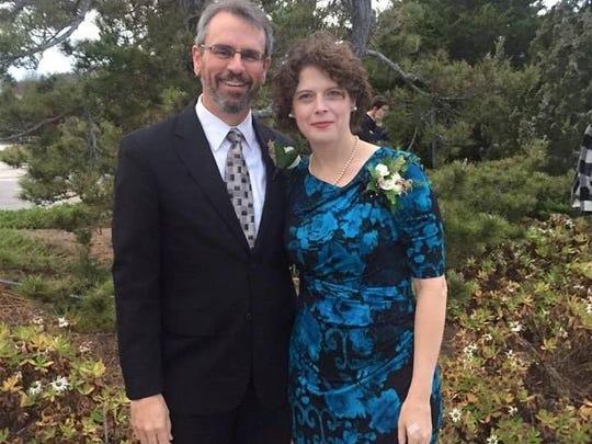 Chester Britt, 54, pictured here with his wife Kelly Champion, died Tuesday after an severe allergic reaction to a wasp sting. He chaired the Department of Sociology at Iowa State University.