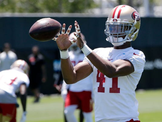 San Francisco 49ers defensive back Ahkello Witherspoon makes a catch during NFL football practice at the team's training facility Tuesday, June 13, 2017, in Santa Clara, Calif. (AP Photo/Marcio Jose Sanchez)