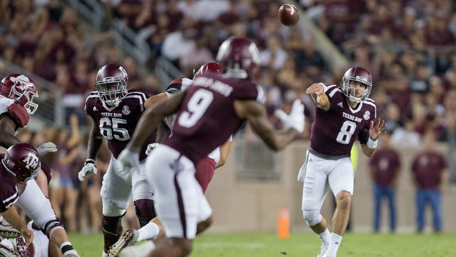 Texas A&M's Trevor Knight (8) completes a pass to Ricky Seals-Jones (9) for a first down against New Mexico State on Saturday at Kyle Field in College Station.