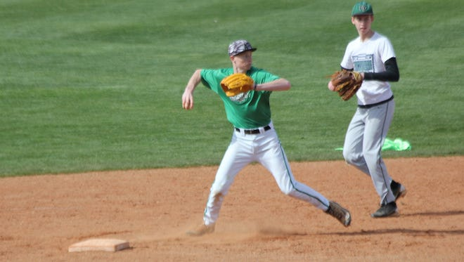 Virgin Valley shortstop Cade Anderson prepares to throw to first base to complete a double play during infield practice.