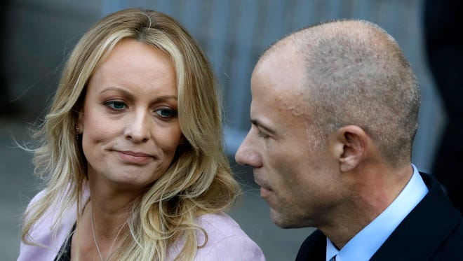 Stormy Daniels, also known as Stephanie Clifford, speaks to reporters with her attorney Michael Avenatti outside of federal court in New York City April 16, 2018.