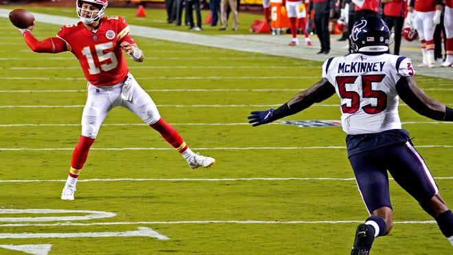 Kansas City Chiefs quarterback Patrick Mahomes (15) throws a pass against Houston Texans linebacker Benardrick McKinney (55) during the first quarter of a game Thursday at Arrowhead Stadium in Kansas City, Missouri.