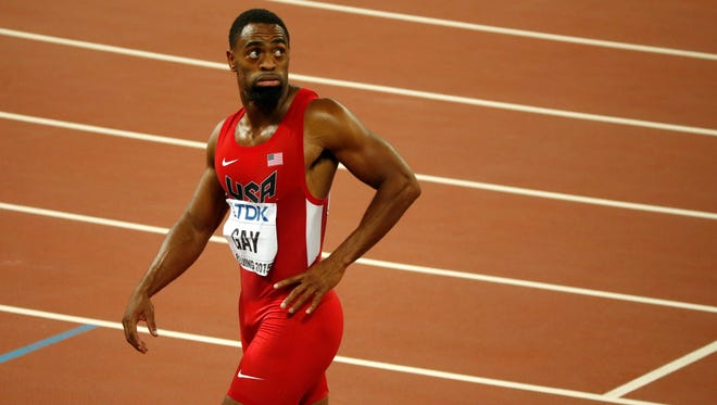 In this Sunday, Aug. 23, 2015, file photo, United States' Tyson Gay leaves the track after the men's 100-meter final at the World Athletics Championships at the Bird's Nest stadium in Beijing. Olympic sprinter Gay is entered in this week's USA Bobsled National Push Championships, making him the latest track star to give sledding a try. (AP Photo/Mark Schiefelbein, File)