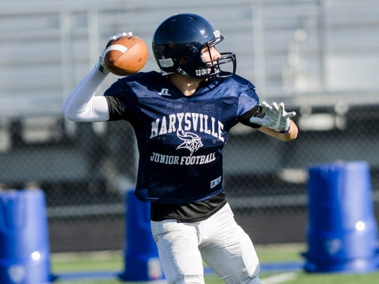 Marysville quarterback Joe Koch looks for an opening to pass the ball to during a practice on Aug. 16. The Vikings will play their first game at Richmond Aug. 24.