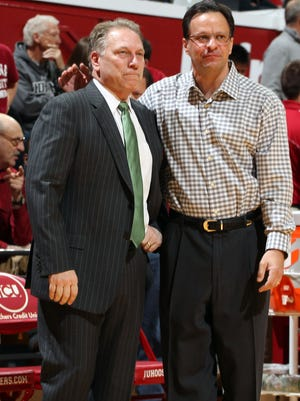 Mar 7, 2015; Bloomington, IN, USA; Indiana Hoosiers coach Tom Crean talks before the game with Michigan State Spartans coach Tom Izzo (left) at Assembly Hall. Mandatory Credit: Brian Spurlock-USA TODAY Sports