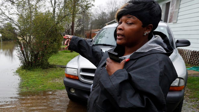 Shirley McDaniel, standing outside her home in Drew, describes how fast the waters flooded her neighborhood, on March 11.