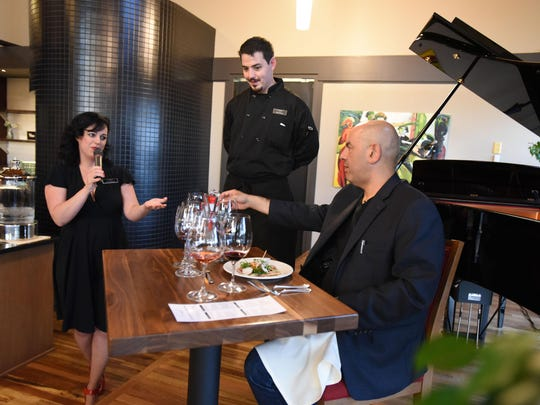 Willamette Valley Vineyards winery chef Quentin Reavis presents his dish, Griffin Marinated Smoked Beef Carpaccio, to Food Network Star Simon Majumdar.