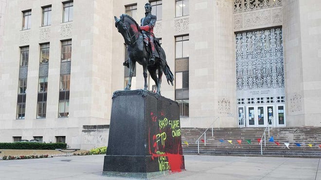 A statue of Andrew Jackson in front of the Jackson County Courthouse in Kansas City is covered with graffiti Thursday after it was vandalized earlier in the day.