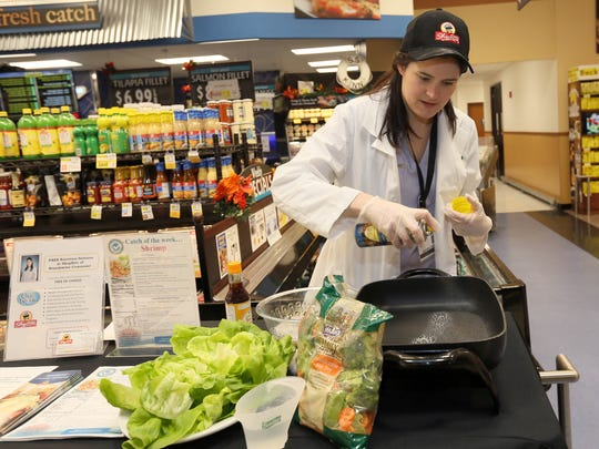 Casey Umile, a registered dietician for Shop Rite, uses cooking spray to cut down on calories when sautŽing foods.