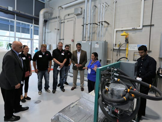 Lucy Mar Camacho, assistant professor in environmental engineering at Texas A&M University-Kingsville, explains her research at the Kay Bailey Hutchinson Desalination Plant's 10th anniversary celebration Sept. 15 in East El Paso.