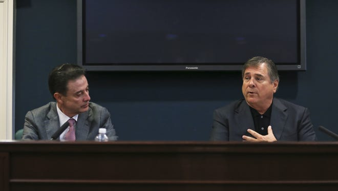 """Louisville coach Rick Pitino looks on as Athletic Director  Tom Jurich said he and the university thought that Pitino had no knowledge of McGee's actions during the NCAA findings press conference at Grawmeyer Hall Thursday. """"I'm not guilty of failing to monitor my staff,"""" Pitino said. """"I'm guilty of trusting someone."""""""