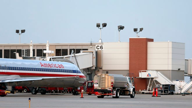 A commercial airline parks at a terminal at the Des Moines International Airport on Tuesday, July 1, 2014, in Des Moines, Iowa.