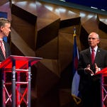 Colorado Gov. John Hickenlooper, left, and candidate Bob Beauprez debate each other Oct. 9 at the Colorado State University Lory Student Center in Fort Collins.