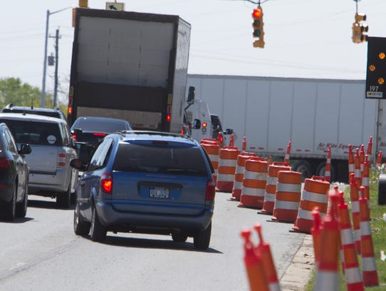 Traffic narrowing down to one lane on Grand River Avenue