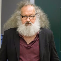 Actor Randy Quaid is seen  being escorted into his Immigration and Refugee Board hearing in Montreal, Thursday.